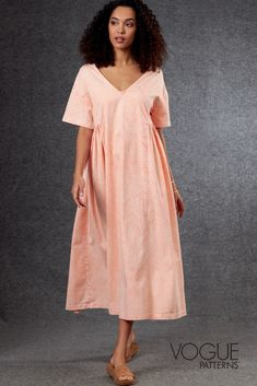 Misses' very loose-fitting, wide V-neck midi dress has dropped shoulders, narrow neck facings, short sleeves, partially seamed & gathered waist, side seam pockets. | Vogue Patterns #sewingpatterns #dresssewingpatterns #dresspatterns #designerpatterns #fashionsewing #womenssewingpatterns #voguepatterns Miss Dress, New Dress, V Neck Midi Dress, Vogue Sewing Patterns, Pattern Sewing, Dress Patterns, Dresses, Women, Short Sleeves