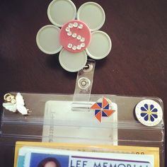 Used medicine vials tops turned into flower badge holders! Recycling+creative co workers!