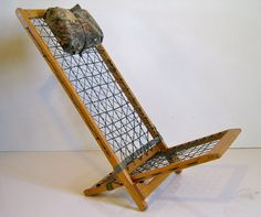 Picture of Paracord Chair: Simple, Comfortable, Adjustable & Collapsible== It is 2 wood frames that cantilever into each other. When laid flat, they make an excellent backpack frame.