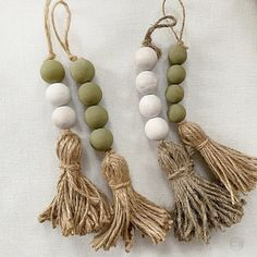 Items similar to 4 Modern farmhouse bead garlands set, Bohemian drawer knob decor with jute tassels, Olive green barn door accent, New home Scandi Hygge gift on Etsy – Furniture and Door Decoration Pearl Garland, Wood Bead Garland, Beaded Garland, Green Barn, Diy 2019, Modern Farmhouse Design, Modern Barn, Farmhouse Style, Farmhouse Decor