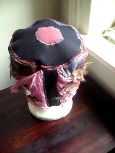 pink and purple silk hat with feathers by Liquidshiva on Etsy, $38.00
