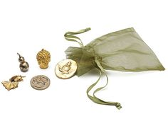 Bag of Zen includes:   - a Buddha and an Om Coin for your daily meditation and reflection   - a gourd for good luck, and to ward off the evil spirits of materialism   - a goldfish for abundance   - a Buddha coin to share