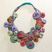 Hand made by female artisans in Peru from reclaimed fabric scraps and multicolored, yarn-wrapped circles. Each is an original work of art. Peru.  Fair Trade Jewelry, Accessories, Gifts - Gaiam
