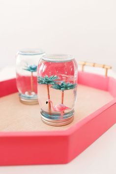 HOW CUTE ARE THESE! My kids are so excited to make these DIY summer snow globes. The flamingos are so cool!
