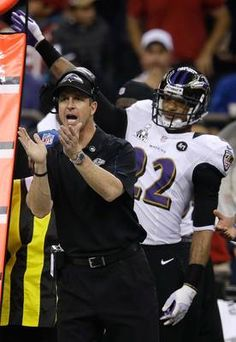 Images from Super Bowl XLVII(87 images)  Updated Feb 4, 2013 3:18 AM ET  Almost there Ravens head coach John Harbaugh and cornerback Jimmy Smith (22) react after the 49ers turned the ball over on downs near the end of the fourth quarter.    Evan Vucci - AP Images