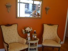 Designed and painted spa boutique. Calming and warm orange color paint with antique furniture and decor.