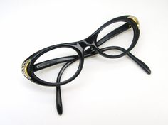 This is a very rare pair of Christian Dior cat eye eyeglasses or sunglasses. They have beautiful silver tone accents. They are in very good vintage condition. Normal wear. Some light whitening on inside nose area. Cant be seen from out side and it is VERY light. Strong five barrel hinges. They have no lens in. Ready to have the lens or your choice put in. Please ask any questions. Check out my shop for more unique vintage eyewear. http://www.etsy.com/shop/Vintage50sEyewear  Lens size - 48mm…