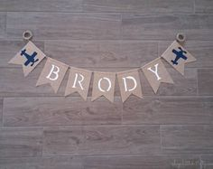 This listing is for a custom airplane name banner. This bunting would look great at your airplane themed baby shower, birthday party, hung in your sons room or as a backdrop for photo shoots. Banner details: * Swallowtail burlap pennants each measuring approximately 4.5 x 6.5 * Airplane on each end with your choice of name in between * Baby name hand painted in your choice of color-all CAPS * Flags are natural burlap, edges have been treated to help minimize fraying * Banner is strung on…