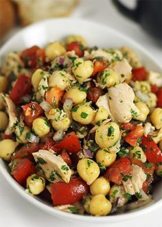 Tuna and chickpea salad A rustic and satisfying salad with chunks of tuna, chickpeas, and chopped vegetables coated in a simple olive oil and lemon dressing. Serves two as a main meal or four as a side salad.