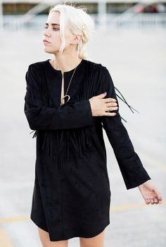 Blogger babe, Courtney Trop wears star pins in her hair with a black fringed dress
