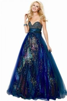 This dress is a gorgeous blend of colors.  It's like they took a peacock and threw it up in a purple sky!