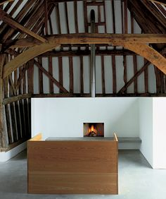 interior by JOHN PAWSON, minimalist architecture and interiors. timber frame Structure. donald judd sofa bed.Living Room, Tilty Barn, Essex, england. 1995. PLAIN SPACE book from Phaidon.