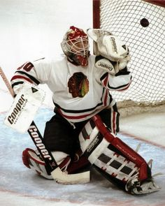1993  Chicago Tribune archive photo / January 15, 2013  Ed Belfour watching a puck fly.