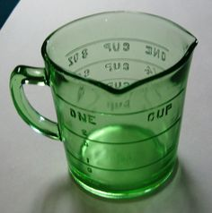 A vintage green glass messing cup.