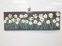 Use fingerprints http://brightestcrayoninthebox-kelly.blogspot.com/2011/05/mothers-day-flowers.html
