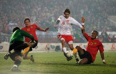 Poland sports | Vincent Kompany Jakub Blaszczykowski of Poland is tackled by Vincent ...