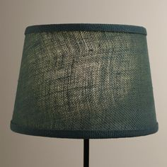 Soft light filters through our Thyme Burlap Accent Lamp Shade, casting a warm glow on your space. This eco-chic shade is made from 100% burlap, a wonderfully versatile material that offers a rustic look.
