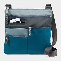 #Patchwork Highway Bag – With plenty of #practical pockets and a spacious interior, this over-the-shoulder bag provides easy access to all of your personal belongings. Made of high-quality Japanese nylon. Pastel blue-green lining #MoMA Exclusive