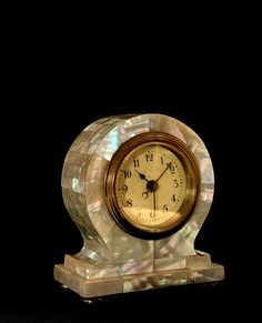 Art Nouveau alarm clock with Mother of Pearl; beautiful design piece clock with alarm; beautiful collector`s piece in working condition.  material / technique: brass with mother of pearls Art Nouveau alarm clock in working condition, dated c. 1900