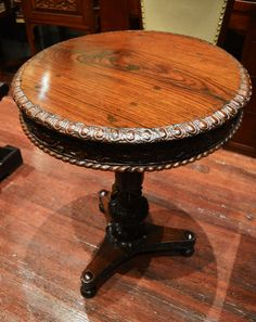 Love this! Hand carved egg and dart motif and foliate apron edge this wonderful tilt-top table.
