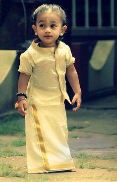 Cute Kerala kid wearing traditional Kerala wear, Kasavu mund and shirt.. super cute, isn't it!!!! 😍