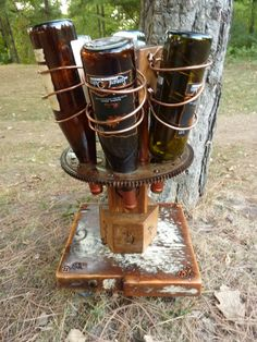 steam punk inspired wine rack with large gear Steampunk Clock, Kitchen Utilities, Reclaimed Barn Wood, Dieselpunk, Steam Punk, Wood Furniture, Wine Rack, Spinning, Crates