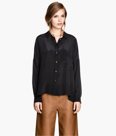 Black oversized silk blouse with long sleeves, chest pocket, side slits. | H&M Modern Classics