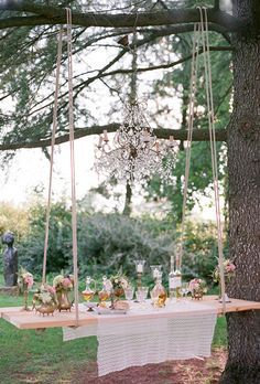 Brides.com: . This garden party featured an olive oil and wine-tasting station on a swing! The planners at The Tuscan Wedding hung a chandelier overhead to add to their enchanted décor.