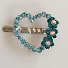 Blue heart magnetic metal hair clip Elegant design with blue and light blue colors rhinestone. Great for any hair colors. Great for wedding, parties, special occasions, gifting or casual wearing. Color: Blue  Material: Alloy, rhinestone, magnet  Size: 1 1/2 inches  Never wore! Accessories Hair Accessories