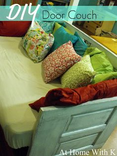 DIY Door Couch -- I love this idea because it's so unique! You can customize it by using your favorite colors and patterns.