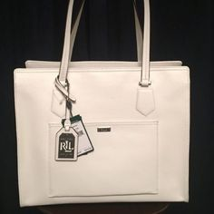 NWT Ralph Lauren White and Black Leather Bag Brand New genuine leather bag- Lowell Tote in vanilla and black. Measures 10 x 6 x 15 - 8 inch strap. No Trades- Make an Offer Ralph Lauren Bags Totes