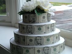 This tiered cake idea might be topped with a paper mortarboard to fit the Student Loan Payoff Party theme. (Courtesy http://john3corrigan.files.wordpress.com/2012/05/money-cake.jpg)