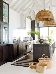 dark cabinets + white beams + oversized natural wicker pendants