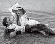 Caroline Trentini and Anna Ewers Play Muse to Charlie Hunnam's Artist – Vogue----A Place In the Sun The Bardot hair, the battered hat, the shimmering light . . . taken as a whole, it's a stand-in for the easeful, freewheeling spirit of the Riviera itself. Model Anna Ewers wears a Gap tuxedo shirt, $70; gap.com. (On hat) Scarf from Melet Mercantile, NYC. On Hunnam: Calvin Klein Underwear tank top.