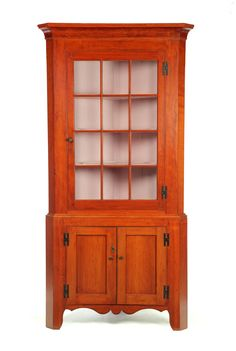 Federal Corner Cupboard.  Midwestern, 1810-1830, cherry and poplar.  Bracket feet with paneled doors in base.  Top has single door with twelve panes of old glass and cove molded cornice.  88.5 H. x 44.5 W. x 24 D.  Requires a 32 inch corner.