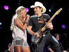 """Country faves – and regular CMA Awards cohosts – Carrie Underwood and Brad Paisley get down while duetting on the final night of the CMA Music Festival in Nashville. """"Hope all you #CMAFest goers had fun this week/weekend,"""" Underwood Tweeted after the show."""