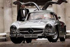 suitsandboots:      FAST FACT #7: The distinctive gullwing doors were implemented to accommodate for the car's tubular chassis, designed by Daimler-Benz's chief developing engineer, Mr Rudolf Uhlenhaut    What an amazing machine. 160mph in the mid '50s.