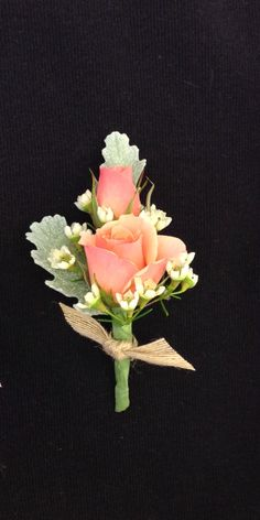 Coral spray roses, and white wax flower boutonniere with burlap accent by Nancy at Belton hyvee.