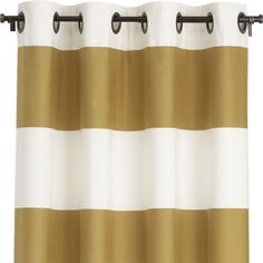 Sophisticated modern panels alternating horizontal bands of ivory cotton and lustrous gold cotton sateen hang from oversized bronze grommets
