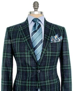 Belvest Navy and Green Bold Plaid Sportcoat 2 button jacket Notch lapel Green melton Front left chest pocket Flap pockets Partially lined Green lining Double vent Drop: 8 95% wool, 5% silk Made in Italy