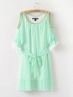 This mint dress is lovely. I found a similar dress and cut in an even better color of a light apricot. The color is fantastic on a sun kissed tan!