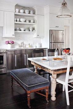 Glamorous Eat In Kitchen. Old weathered farm table in sleek modern kitchen. I love the navy velvet bench.