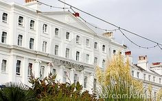 The exterior of a white painted seaside hotel in Eastbourne in East Sussex England.