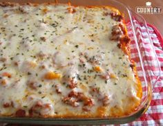 This easy baked ziti is a HUGE family favorite. We make it several times a month. Creamy, cheesy pasta topped with a beefy spaghetti sauce!