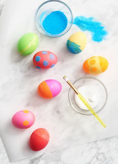 Add a little extra shine to dyeing Easter eggs one with glitter and glue. Make sure the eggs have completely dried after dyeing them. Then use adhesive strips or paint brushes to create patterns like polka dots and stripes. Dip the eggs into your glitter of choice and—voilà! A brilliant array of Easter eggs. Get set for Easter at Kohl's.
