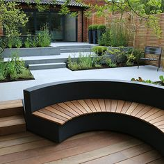 Stylish curved wooden bench. Rosemary Coldstream MSGD