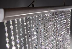 "71"" tall x 35"" wide iridescent acrylic crystal curtain with 34 garlands $19"