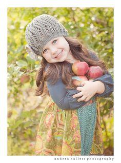 Little girl harvesting.  Cute!  Such a classic photography look and feel.  :)