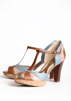 """These classic leather heels in cognac, mauve, and blue are perfected with an adjustable ankle strap, a sleek stacked heel, and cork sole.  Man-made materials balance, Leather upper, 3.25"""" heel height, Slightly padded footbed"""
