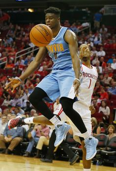 Erick Green #11 of the Denver Nuggets battles for the basketball against Trevor Ariza #1 of the Houston Rockets during their game at the Toyota Center on October 28, 2015 in Houston, Texas.